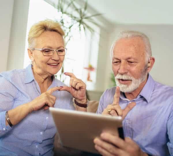 elderly couple using jeenie interpreter on ipad